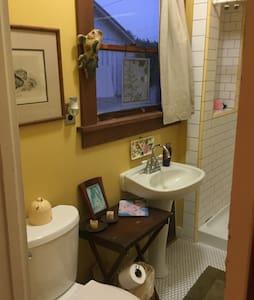Full-size bathroom but the door is not wheelchair friendly