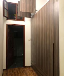 Bathroom entrance + walk in closet