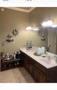 Large bathroom with access from bedroom  And privacy door. Walk-in shower. Lots of towels, hairdryer, soap, shampoo, coffee maker Etc for your convenience.