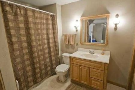 This is the ground floor bathroom with tub/shower.   The washer and dryer is also in this room behind louvered doors