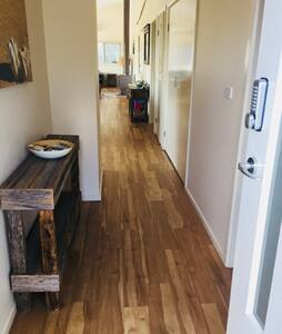 Entrance measures 1340mm to master bedroom with ensuite.  Min. Hallway measurement = 930mm