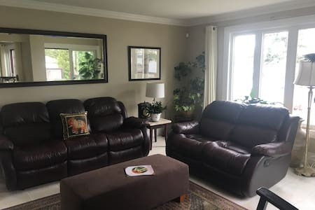 Main floor living area, extra large entrance/hallway, open to dining room, kitchen, bathroom and deck.