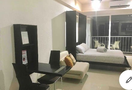It is a nice and wide studio size unit with no door for the bedroom .