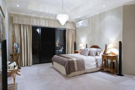 Master Bedroom Suite (downstairs) has room around the bed for wheelchair access.  Please ask, if additional furniture or equipment is needed for your comfort or access.