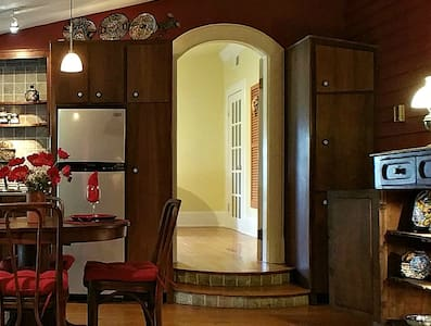 There are two steps leading into the bedroom. All the other floors are flat and on the same level. A walker can easily fit through this generous sized door.
