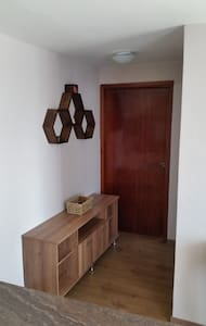 Entrance to the bathroom on the right side