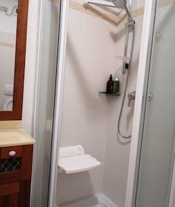 Cadira a la dutxa