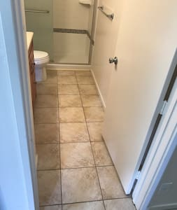 """Entrance to 2nd  full bathroom with walk-in shower (6"""" ledge)."""