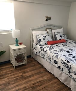 Large bedroom with new hybrid super comfy Queen mattress, with enough space to walk around bed and, over 5 feet of space on the nightstand side!