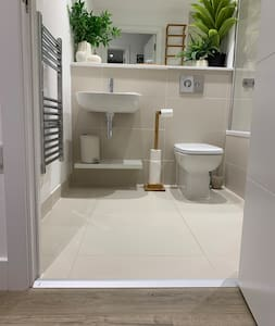 Level entrance to bathroom