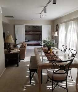 Double door entrance to 3rd bedroom which consists of bunk beds. Twin on top & full in bottom.  Has sliding glass door with private balcony.