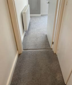 No steps to enter the main bedroom.