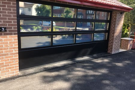 Large glazed door for entry of large items/wider wheelchairs or mobility scooters