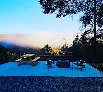 Big backyard patio with firepit, picnic table, chairs...Overlooking the beautiful Rolling CliffTop!