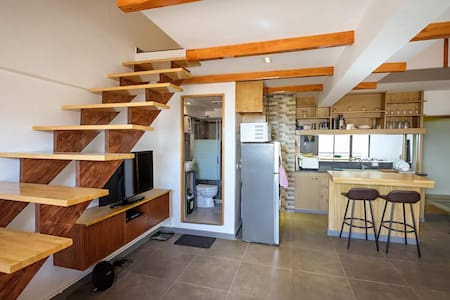 Since this is a loft room, there is a stairs to get in the main bedroom. You dont have to worry it is very safe sturdy hardwood type of wood we used.