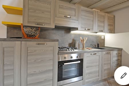 Kitchen with cooking Oven fridge freezer