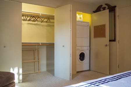 """There is ample room (40+ inches) between the foot of the bed and the closet; also there is easily 40"""" on either side of the king size bed."""
