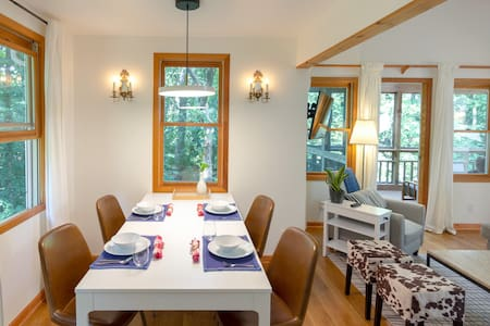 There's easy access to the dining table from the main living area. The stools can be moved for more room.