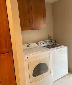 Laundry room next  to the kitchen area.