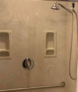 Walk-in shower with hand held shower