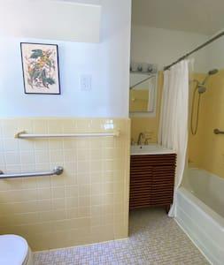 Hand held shower heads in both bathrooms