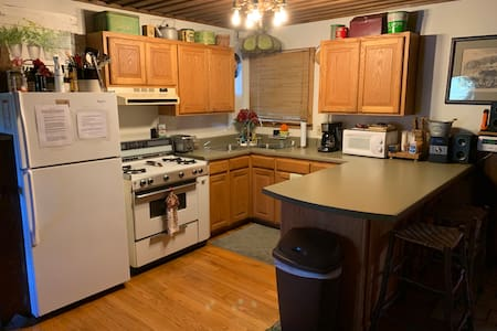 """Small kitchen has 48"""" width between counter and stove with standard height cabinetry and appliances."""