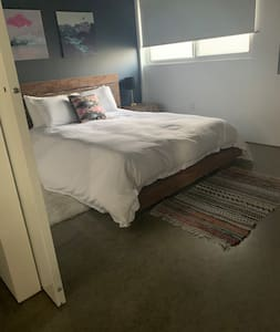 Open entrance to bedroom off kitchen