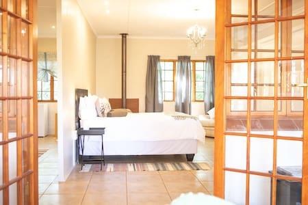 Double doors open to the bedroom area