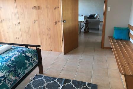 Bedroom doorway to main living area and kitchen