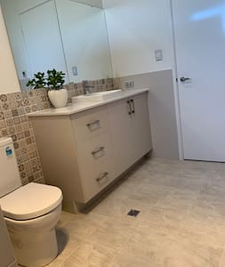 Wide space to toilet shower too!