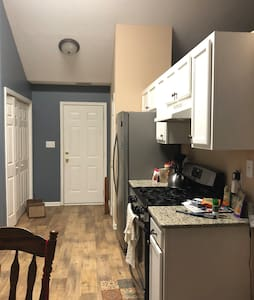 Washer and dryer are behind the double doors.