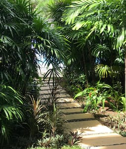 10-15 walk through lush greenery to the pool. The beauty of the lush greenery is that other guests cannot see our apartment.   There is also another lap pool by the gym. That's another 1 mins walk to the other lap pool by the gym