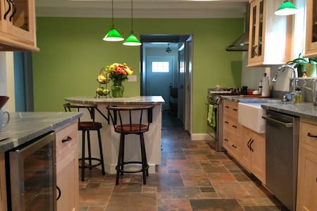 There are three doorways into kitchen, all on one level with no steps or ramps. Here you can see entrance from back hallway, 40 in wide. To left of kitchen island is an entrance from the center hallway, 36 in wide.