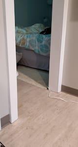 flat entry into the bedroom. doorway width is 28in wide.