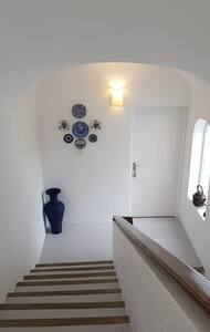 wide doorway and wide staircase.