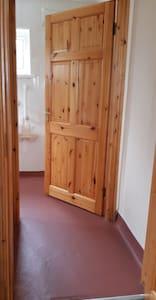 Wide doorway to bathroom