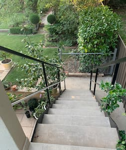 Stairs to up to balcony to enter apartment.