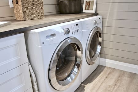 Full size washer and dryer (gas) are in the spacious bathroom.