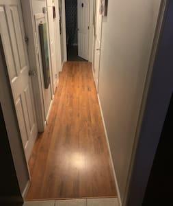 Hallway to downstairs bathroom