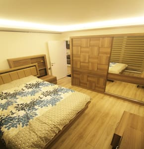 Living room with wide space and fully newly furnished. King bed and dressing, sliding door capote