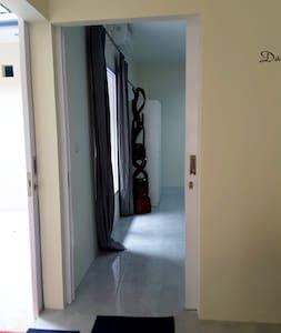 Sliding door to the bedroom, 100 cm / 39 in wide.