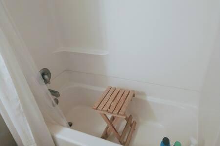 Badekar med brusestol