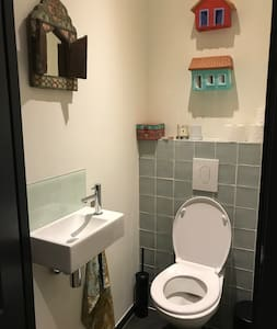Toilet has sink and seat is 46 cm from the floor