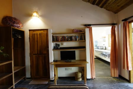 Entrance to the kitchen to the right of the photo
