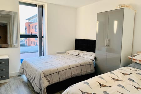 One single bed and one double bed with plenty of space around both beds