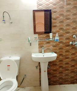 Private washroom with cubicle , shower , basic toiletries and fragrance