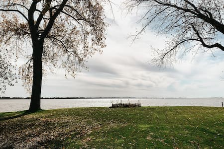 Very large backyard directly on the lake. Perfect for cornhole/ bean bag board playing (included With the property) or any other yard activities!