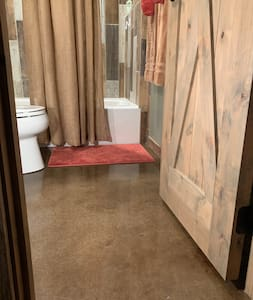 """Barrier free entry to bathroom. Doorway is approximately 23"""" wide."""