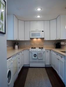 Galley kitchen - flat and easily accessible.