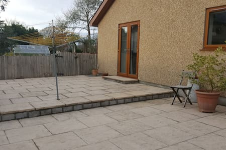 Wide step on patio then 2 steps via patio doors. This is not the main entrance.